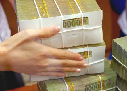 Từ 1/5, lương tối thiểu tăng 220.000 đồng. Ảnh: Hoàng Hà