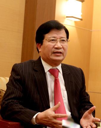 Bộ trưởng Xây dựng Trịnh Đình Dũng. Ảnh: Hoàng Lan