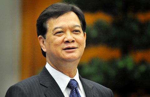 Thủ tướng đánh giá cao vai trò của Ngân hàng Nhà nước trong việc đưa lạm phát năm 2012 về 6,8%. Ảnh: Hoàng Hà.