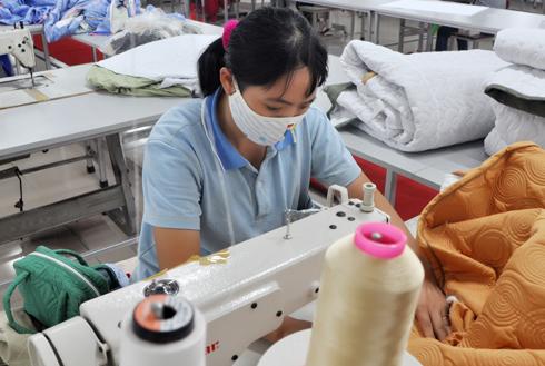 Ngành dệt may Việt Nam được giới chuyên gia đánh giá cao. Ảnh: Anh Quân
