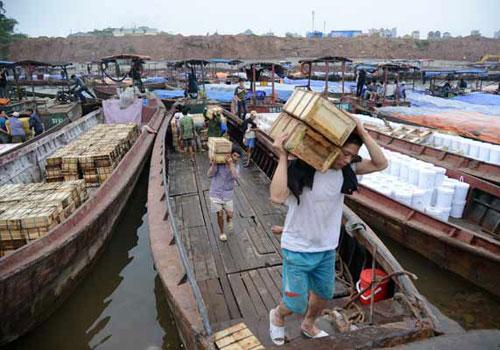 Trung Quốc chăm mua nguyên liệu thô, ít đầu tư vào Việt Nam Vietnam-trung-quoc-7556-1399620667