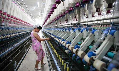 det 0 8710 1434621446 Trung Quốc đang trong tình trạng khá chật vật tái cơ cấu sản xuất