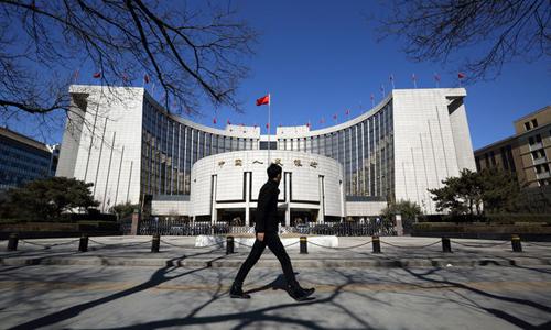 ngân hàng Trung ương Trung Quốc cho biết đang áp dụng cơ chế thả nổi có kiểm soát. Ảnh: Bloomberg