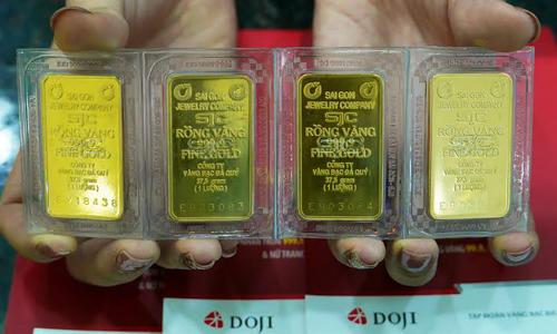 Giá vàng, đôla yên ắng sau tin lãi suất gửi ngoại tệ về gần 0% 1