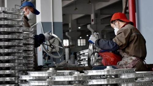 Trung Quốc sẽ giảm dư thừa sản xuất công nghiệp trong năm nay. Ảnh: AFP