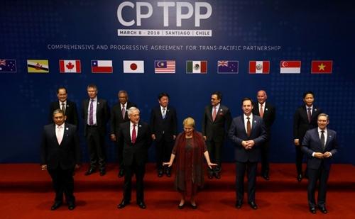 Đại diện các nước tham gia ký kết CPTPP tại Chile. Ảnh: Reuters