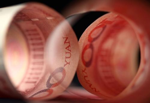 Đồng 100 NDT của Trung Quốc. Ảnh: Bloomberg