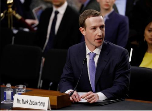 CEO Facebook - Mark Zuckerberg trong buổi điều trần. Ảnh: Reuters