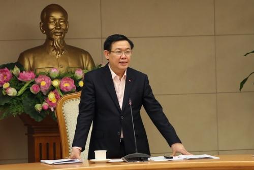 Phó Thủ tướng Vương Đình Huệ chủ trì cuộc họp nghe báo cáo triển vọng kinh tế vĩ mô 2018. Ảnh: VGP.