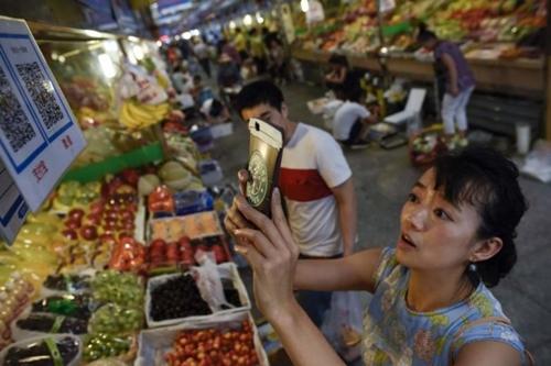 Thanh toán di động chật vật thay thế tiền mặt ở Đông Nam Á