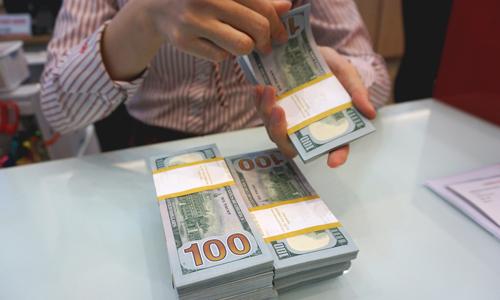 Tỷ giá USD/VND có thể sẽ bị ảnh hưởng khi Mỹ - Trung chiến tranh thương mại.