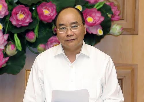 Thủ tướng Nguyễn Xuân Phúc chỉ đạo ở cuộc họp Hội đồng giải đáp chính sách bán hàng tiền tệ quốc gia chiều 18/7. Ảnh: VGP