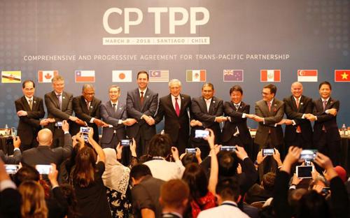 Đại diện những nước tham dự ký kết CPTPP ở Chile. Ảnh: Reuters