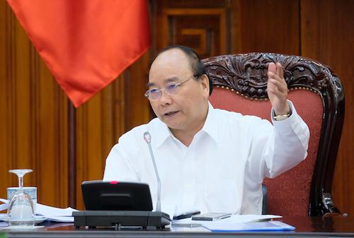 Thủ tướng Nguyễn Xuân Phúc chỉ đạo ở cuộc họp thường trực Chính phủ chiều 25/7. Ảnh: VGP