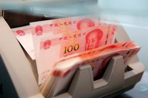 Tính từ đầu năm, đồng nhân dân tệ đã giảm hơn 5% so với đôla Mỹ. Ảnh: Reuters.