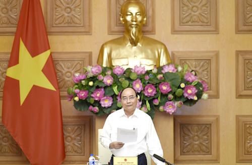 Thủ tướng làm việc với Tổ tư vấn kinh tế ngày 23/8. Ảnh: VGP