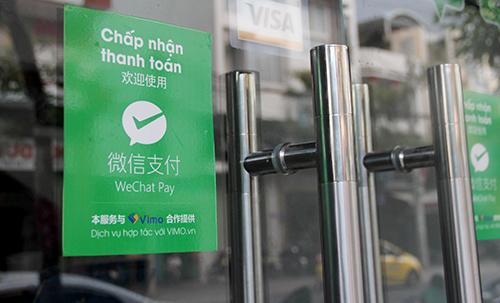 Một cửa hàng ở Nha Trang (Khánh Hoà) chấp nhận thanh toán qua Wechat Pay cho khách Trung Quốc. Ảnh: An Phước