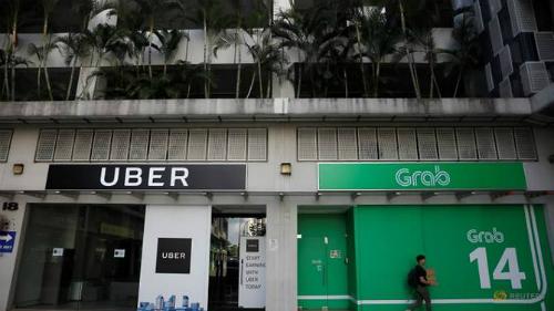 Một góc văn phòng của Uber và Grab chụp vào ngày 26/3/2018. Ảnh: Reuters