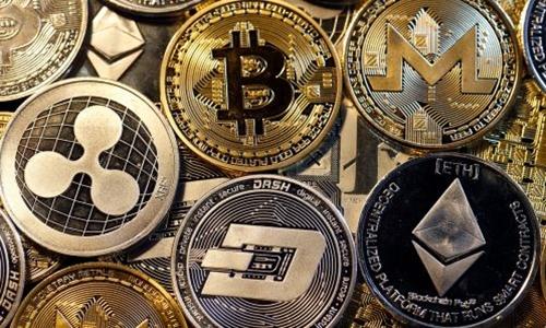 Hình mô phỏng các loại tiền kỹ thuật số phổ biến trên thế giới. Ảnh: AFP