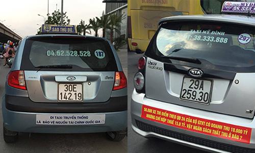 Các hãng taxi truyền thống treo biểu ngữ phản đối Uber, Grab năm ngoái. Ảnh: Anh Tú