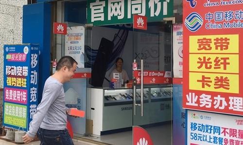 Nông dân Trung Quốc dùng hàng hiệu - Kinh Doanh
