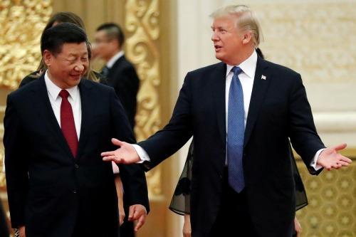 Chủ tịch Trung Quốc - Tập Cận Bình và Tổng thống Mỹ - Donald Trump. Ảnh: Reuters