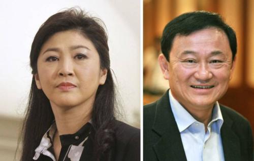 Hai cựu thủ tướng Thái Lan - Yingluck và Thaksin Shinawatra. Ảnh: Reuters