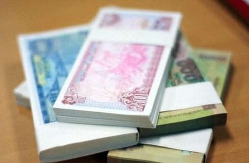 Tền lẻ mới in mệnh giá từ 10.000 đồng trở xuống không được đưa vào lưu thôngdịp Tết. Ảnh: Nhật Minh.