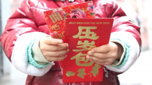 Trẻ con có thể họckỹ năng quản lý tài chính từ tiền lì xì.Ảnh: Rebecca Kanthor