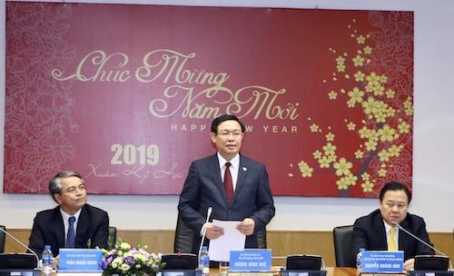 Phó thủ tướng Vương Đình Huệ (giữa) làm việc với Uỷ ban vốn Nhà nước tại doanh nghiệp ngày 11/2. Ảnh: VGP