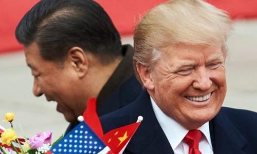 Chủ tịch Trung Quốc - Tập Cận Bình và Tổng thống Mỹ - Donald Trump tại Bắc Kinh. Ảnh:AFP