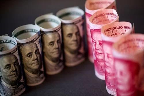 Trung Quốc tăng giá nhân dân tệ trở lại - ảnh 1