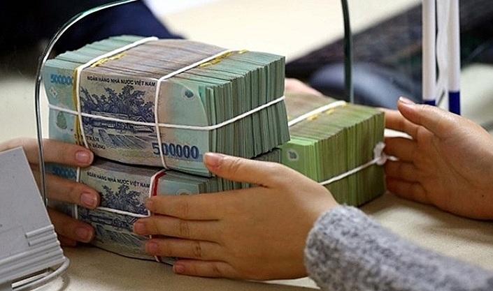 Ngân hàng ráo riết thu hồi nợ xấu - ảnh 1