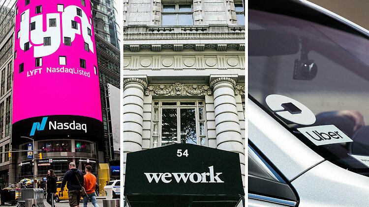 Logo Lyft, WeWork và Uber trên đường phố Mỹ. Ảnh: NYT