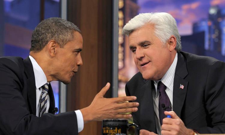Triệu phúJay Leno trò chuyện cùng cựu Tổng thống Obama trong một chương trình truyền hình. Ảnh: AP.