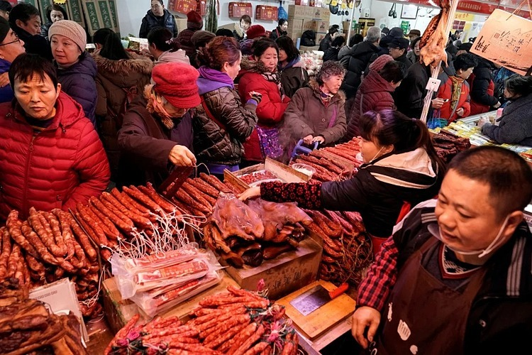 Tết Nguyên đán là mùa cao điểm tiêu thụ thịt heo tại Trung Quốc. Ảnh: Reuters