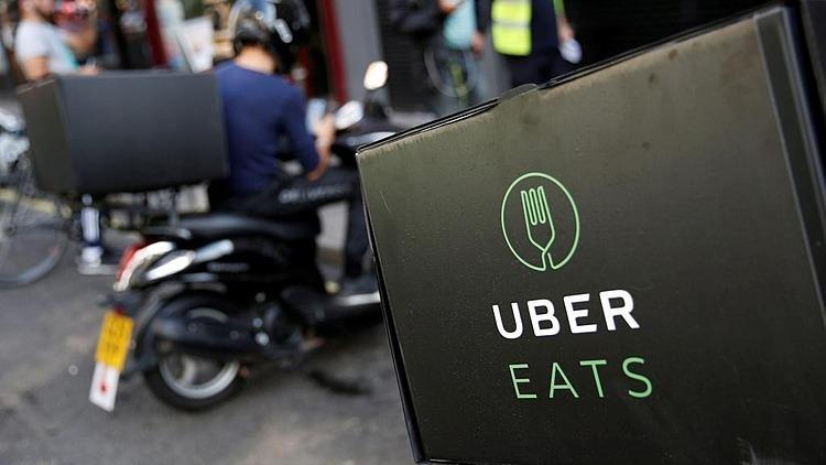 Dịch vụ giao đồ ăn Uber Eats của Uber. Ảnh: Reuters